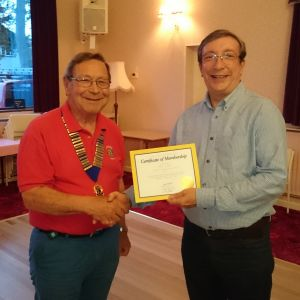 Lion President Roger Munday inducts new Lion Mark Cooper
