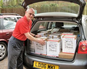 Lion Grahame Pullen delivering 4,000 used spectacles